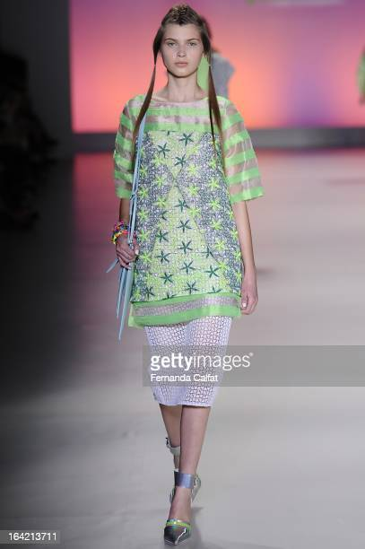 Model walks the runway at the Triton show during Sao Paulo Fashion Week Summer 2013/2014 on March 20, 2013 in Sao Paulo, Brazil.