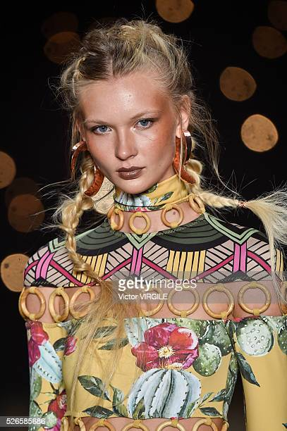 A model walks the runway at the Triya fashion show during the Sao Paulo Fashion Week Spring/Summer 20162017 on April 27 2016 in Sao Paulo Brazil