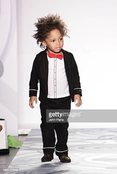 A model walks the runway at the Truly Scrumptious for Babies 'R' Us designed by Heidi Klum at Vogue Bambini petiteParade Kids Fashion Week on October...