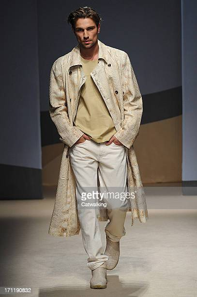 A model walks the runway at the Trussardi Spring Summer 2014 fashion show during Milan Menswear Fashion Week on June 23 2013 in Milan Italy