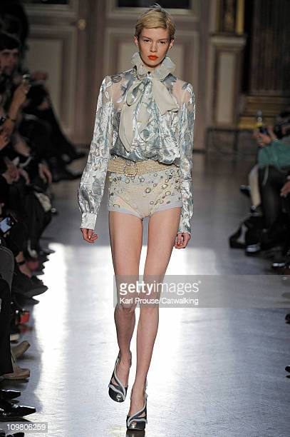 Model walks the runway at the Tsumori Chisato fashion show during Paris Fashion Week on March 5, 2011 in Paris, France.