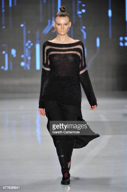 A model walks the runway at the Tuba Ergin show during MBFWI presented by American Express Fall/Winter 2014 on March 10 2014 in Istanbul Turkey