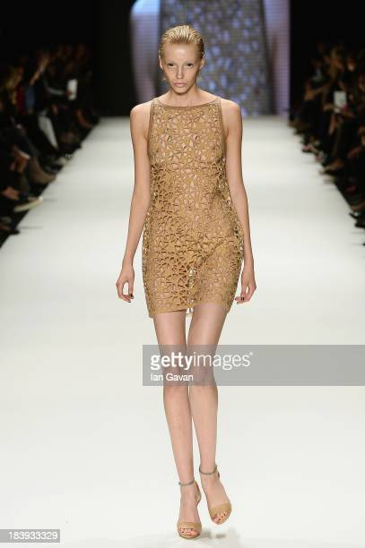A model walks the runway at the Tuba Ergin show during MercedesBenz Fashion Week Istanbul s/s 2014 Presented By American Express on October 10 2013...