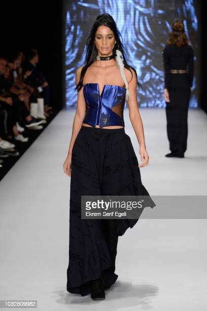 A model walks the runway at the Tuba Ergin show during the MercedesBenz Istanbul Fashion Week at Zorlu Performance Hall on September 13 2018 in...
