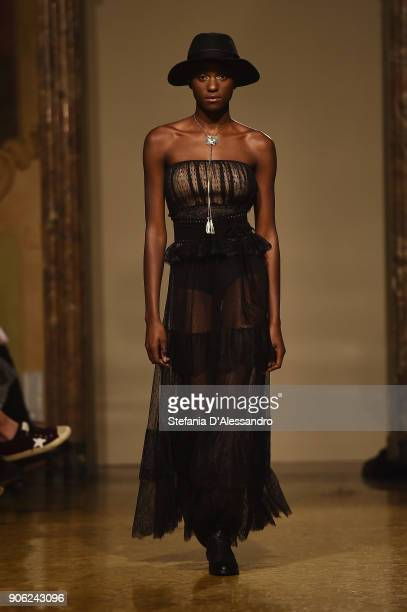 A model walks the runway at the Twinset show on January 17 2018 in Milan Italy