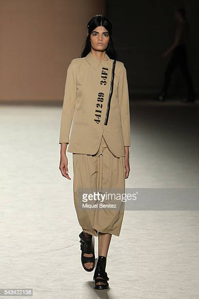 A model walks the runway at the Txell Miras show during the Barcelona 080 Fashion Week Spring/Summer 2017 at the INEFC Institut Nacional de Educacio...