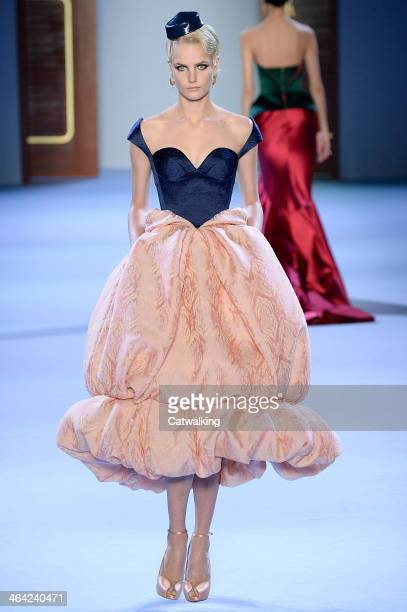 A model walks the runway at the Ulyana Sergeenko Spring Summer 2014 fashion show during Paris Haute Couture Fashion Week on January 21 2014 in Paris...