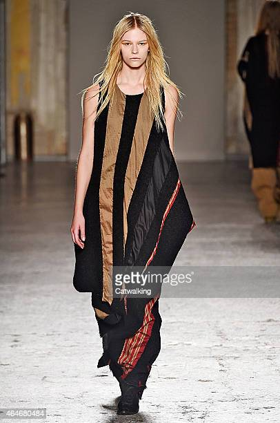 e98c7eecb51 A model walks the runway at the Uma Wang Autumn Winter 2015 fashion show  during Milan