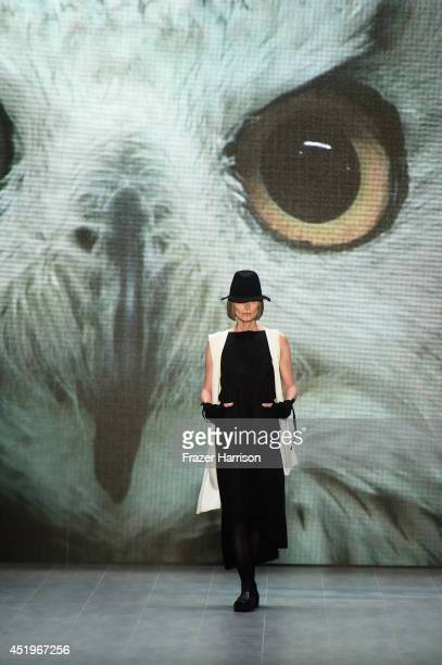 Model walks the runway at the Umasan show during the Mercedes-Benz Fashion Week Spring/Summer 2015 at Erika Hess Eisstadion on July 10, 2014 in...
