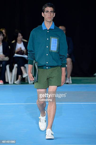 A model walks the runway at the Umit Benan Spring Summer 2015 fashion show during Paris Menswear Fashion Week on June 29 2014 in Paris France