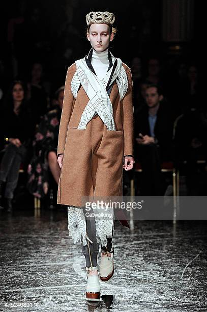 Model walks the runway at the Undercover Autumn Winter 2014 fashion show during Paris Fashion Week on February 26, 2014 in Paris, France.