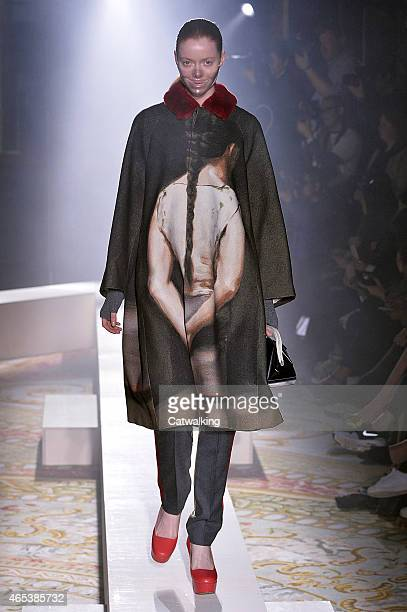 Model walks the runway at the Undercover Autumn Winter 2015 fashion show during Paris Fashion Week on March 6, 2015 in Paris, France.