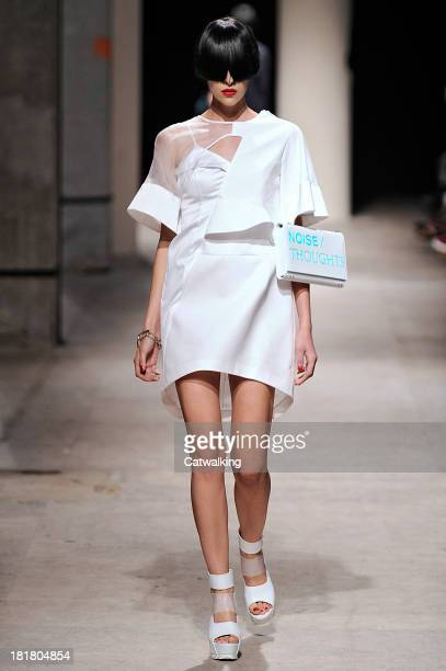 Model walks the runway at the Undercover Spring Summer 2014 fashion show during Paris Fashion Week on September 25, 2013 in Paris, France.