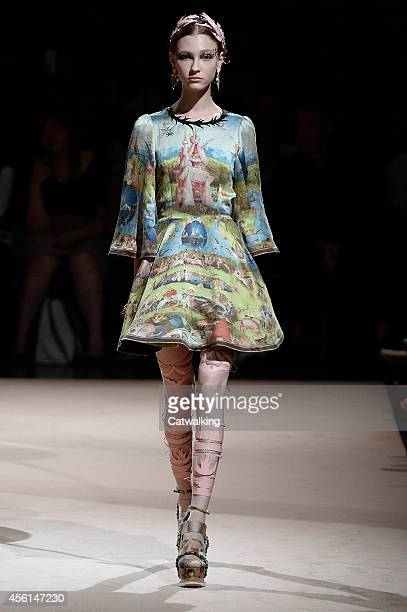 Model walks the runway at the Undercover Spring Summer 2015 fashion show during Paris Fashion Week on September 26, 2014 in Paris, France.