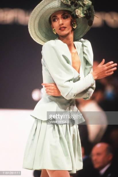A model walks the runway at the Ungaro Ready to Wear Spring/Summer 1992 fashion show during the Paris Fashion Week in October 1991 in Paris France