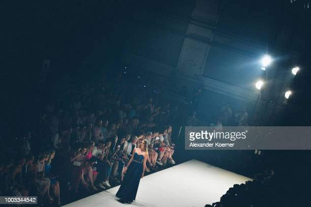 A model walks the runway at the Unique by Lexus show during Platform Fashion July 2018 at Areal Boehler on July 21 2018 in Duesseldorf Germany