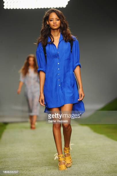 Model walks the runway at the Unique show during London Fashion Week SS14 at TopShop Show Space on September 15, 2013 in London, England.