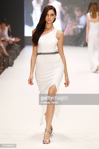 A model walks the runway at the Unique show during Platform Fashion July 2016 at Areal Boehler on July 23 2016 in Duesseldorf Germany