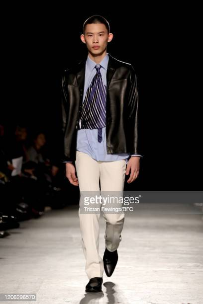 Model walks the runway at the University of Westminster show during London Fashion Week February 2020 at Ambika P3 on February 14, 2020 in London,...