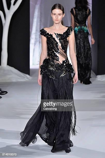 Model walks the runway at the Valentin Yudashkin Autumn Winter 2016 fashion show during Paris Fashion Week on March 6, 2016 in Paris, France.