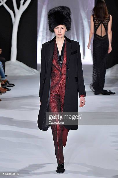 A model walks the runway at the Valentin Yudashkin Autumn Winter 2016 fashion show during Paris Fashion Week on March 6 2016 in Paris France