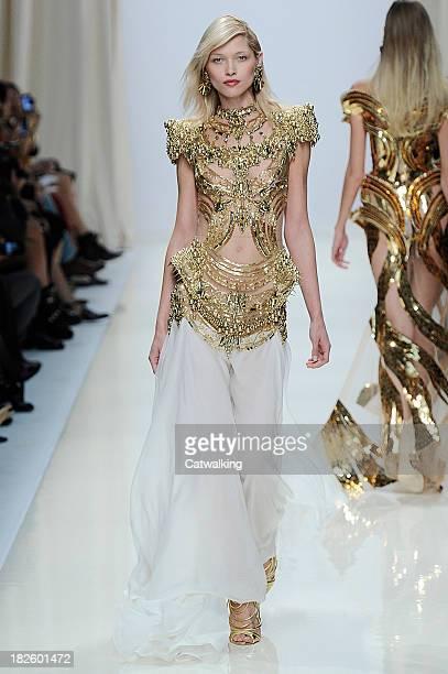 Model walks the runway at the Valentin Yudashkin Spring Summer 2014 fashion show during Paris Fashion Week on October 1, 2013 in Paris, France.
