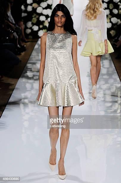 Model walks the runway at the Valentin Yudashkin Spring Summer 2015 fashion show during Paris Fashion Week on September 30, 2014 in Paris, France.