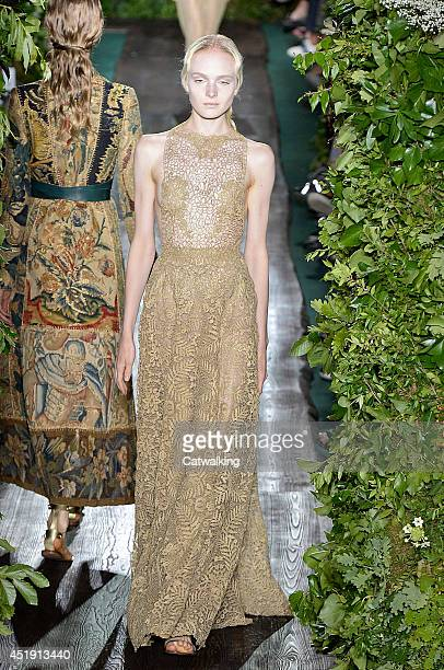 A model walks the runway at the Valentino Autumn Winter 2014 fashion show during Paris Haute Couture Fashion Week on July 9 2014 in Paris France