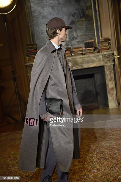 A model walks the runway at the Valentino Autumn Winter 2017 fashion show during Paris Menswear Fashion Week on January 18 2017 in Paris France