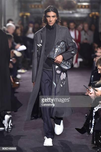 A model walks the runway at the Valentino Autumn Winter 2018 fashion show during Paris Menswear Fashion Week on January 17 2018 in Paris France