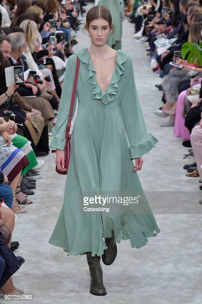 A model walks the runway at the Valentino Autumn Winter 2018 fashion show during Paris Fashion Week on March 4 2018 in Paris France