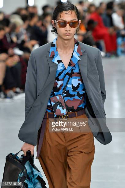 A model walks the runway at the Valentino fashion show during Paris Men's Fashion Week Spring/Summer 2020 on June 19 2019 in Paris France