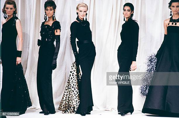 Model walks the runway at the Valentino Haute Couture Fall/Winter 1990-1991 fashion show during the Paris Fashion Week in July, 1990 in Paris, France.