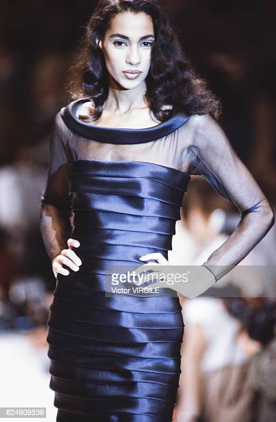 Model walks the runway at the Valentino Ready to Wear Fall/Winter 1991-1992 fashion show during the Paris Fashion Week in March, 1991 in Paris,...