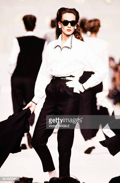 A model walks the runway at the Valentino Ready to Wear Spring/Summer 1989 fashion show during the Paris Fashion Week on October 1988 in Paris France
