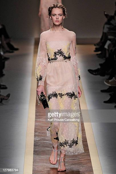 A model walks the runway at the Valentino Spring Summer 2012 fashion show during Paris Fashion Week on October 4 2011 in Paris France
