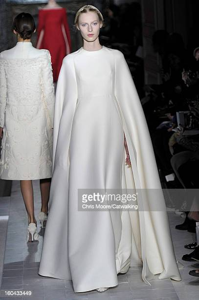 A model walks the runway at the Valentino Spring Summer 2013 fashion show during Paris Haute Couture Fashion Week on January 23 2013 in Paris France