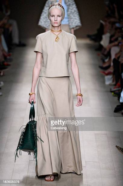 A model walks the runway at the Valentino Spring Summer 2014 fashion show during Paris Fashion Week on October 1 2013 in Paris France