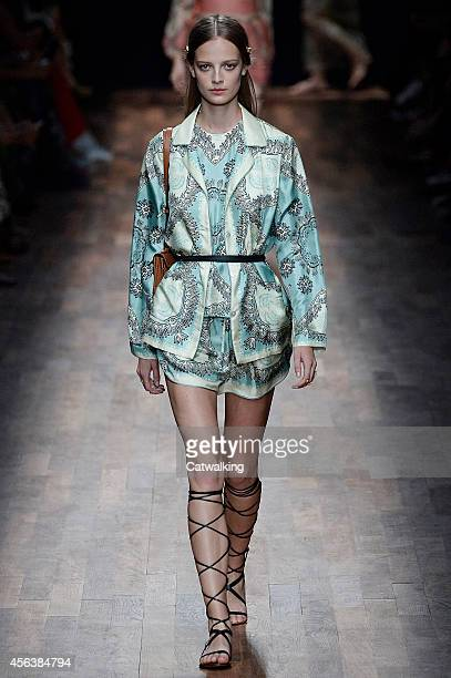 A model walks the runway at the Valentino Spring Summer 2015 fashion show during Paris Fashion Week on September 30 2014 in Paris France