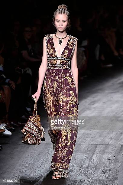 A model walks the runway at the Valentino Spring Summer 2016 fashion show during Paris Fashion Week on October 6 2015 in Paris France