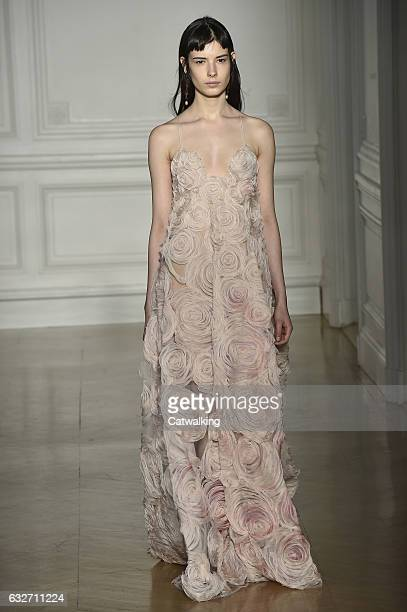 A model walks the runway at the Valentino Spring Summer 2017 fashion show during Paris Haute Couture Fashion Week on January 25 2017 in Paris France