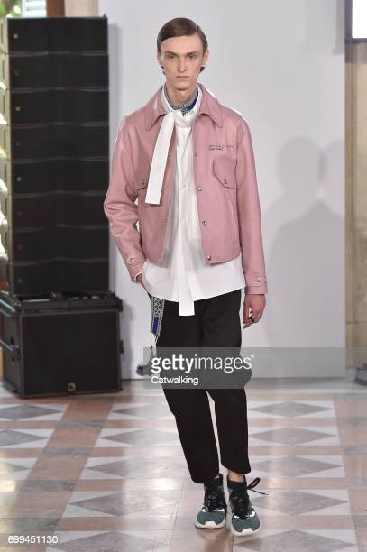 A model walks the runway at the Valentino Spring Summer 2018 fashion show during Paris Menswear Fashion Week on June 21 2017 in Paris France