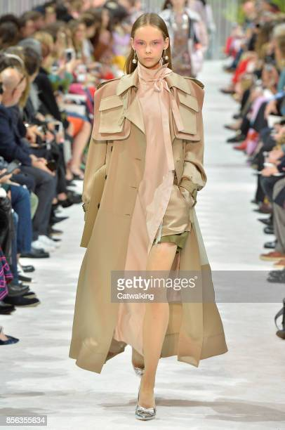 A model walks the runway at the Valentino Spring Summer 2018 fashion show during Paris Fashion Week on October 1 2017 in Paris France
