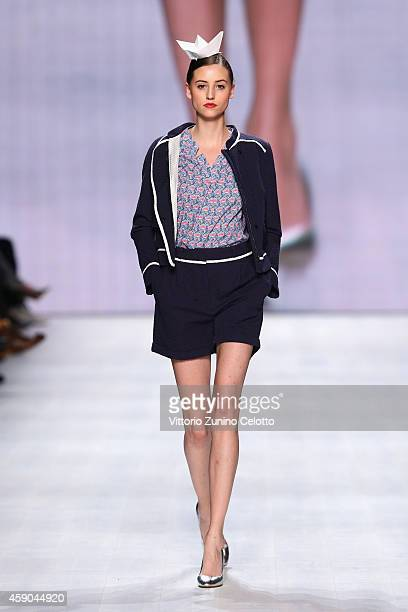 A model walks the runway at the Van Bery show during the MercedesBenz Fashion Days Zurich 2014 on November 15 2014 in Zurich Switzerland