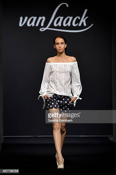 A model walks the runway at the Van Laack Show during Platform Fashion Duesseldorf on July 26 2014 in Dusseldorf Germany