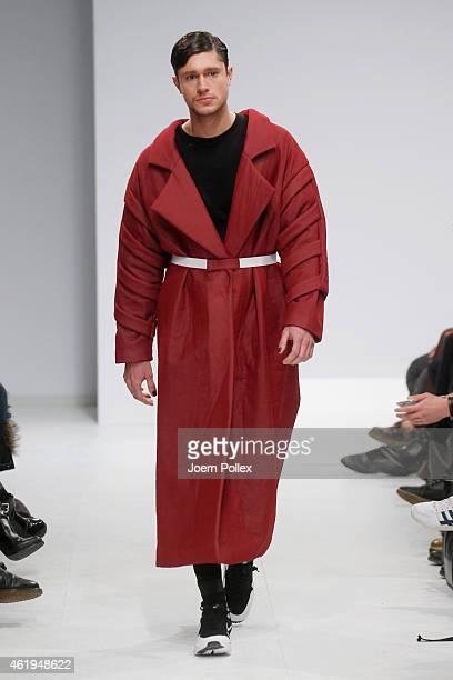 A model walks the runway at the Vektor show during the MercedesBenz Fashion Week Berlin Autumn/Winter 2015/16 at Brandenburg Gate on January 22 2015...