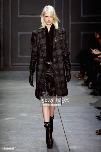 A model walks the runway at the Vera Wang Collection fashion show during MercedesBenz Fashion Week Fall 2014 at Dia Center on February 11 2014 in New...