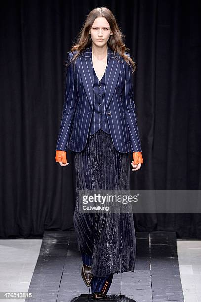 A model walks the runway at the Veronique Branquinho Autumn Winter 2014 fashion show during Paris Fashion Week on March 3 2014 in Paris France