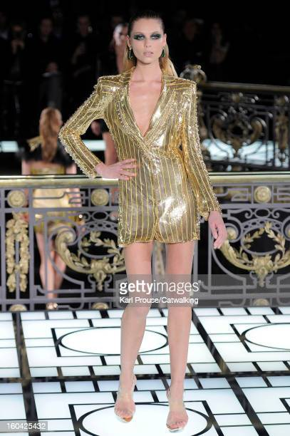 A model walks the runway at the Versace Atelier Spring Summer 2013 fashion show during Paris Haute Couture Fashion Week on January 20 2013 in Paris...