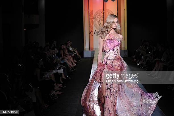 Model walks the runway at the Versace Autumn Winter 2012 fashion show during Paris Haute Couture Fashion Week on July 1, 2012 in Paris, France.